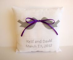 ring bearer pillow with bow and rings in mouth