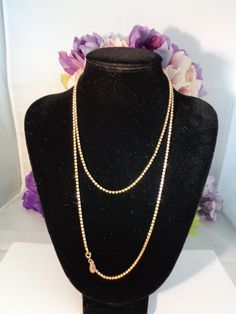 "10% off! Les Bernard Rhinestone and Goldtone Necklace featuring a Goldtone Clasp. The string of Rhinestones set in Goldtone Measures 35"". This Necklace is by Les Bernard, we have a pair of Goldtone and Rhinestone Earrings by Les Bernard on the way. Things will be arriving every day until The Father's Day Big Sale. Have  a great vintage day Best, Coco www.CCCsVintageJewelry.com"