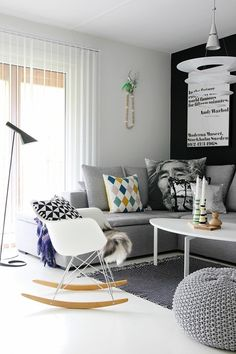 Grey walls and gray couch with pop of color