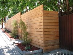 Would love a modern, horizontal front yard fence like this. The 'formal' garden goes in front and on the street strip, and then behind the wall hides all the lovely, chaotic veggies. ;)
