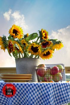 Sunflower in a Galvanized Bucket, Gingham Tablecloth, and a Wire Farmhouse Basket Filled with Fall Apples Autumn Decorating, Fall Decor, Yellow Dinner Plates, Gingham Tablecloth, Fancy Dishes, Apple Decorations, Apple Season, Fall Table, Diy Table