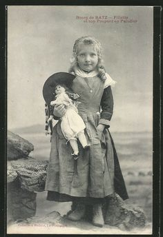 Victorian girl holding her doll