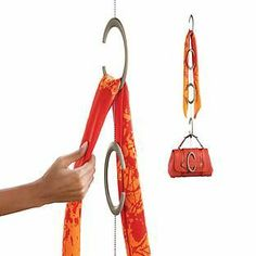 Simple yet smart! Our C-Link by Umbra® helps maximize your closet's vertical space by keeping scarves, ties, belts and handbags organized, visible and accessible. Handbag Organization, Closet Organization, Dorm Room Checklist, Hanging Scarves, Space Saving Hangers, Container Store, Closet Storage, Jewellery Storage, Cool Stuff