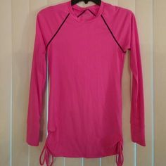 TYR workout top Deep pink long sleeved workout top with black stitching at the top in front and back of shirt. Has draw string pulls at the bottom on both sides. Like brand new condition from smoke free and pet free home. Fits more like a medium than a small TYR Tops
