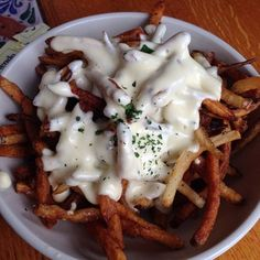 Brie fries from Baie Rouge in New Orleans | 23 French Fries You Need To Eat Before You Die