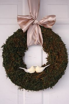 Turtle dove wreath. But would be a great love bird wreath idea for a wedding reception or shower.