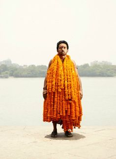 Let APT introduce you to the gentlemen of Asia's largest flower market. The vendors of the Mallick Ghat Bazaar in Calcutta are the unlikely subjects of photographer Ken Hermann's Flower Man series. APT is tickled by the images of such earnest men cloaked in delicate and vibrant florals. It's flower power like we've never seen before.
