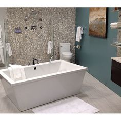Emser Tile Venetian Pebbles Mosaic Tile in Medici Blend.  This looks great with the grey tile.  This one could be it!