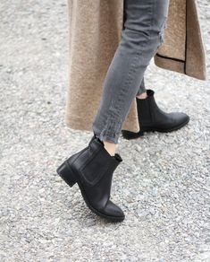 Get stylish this winter with Chelsea boots that are actually stylish winter boots! Outfit with Camel Coat & Striped Sweater on shoe-tease.com