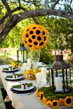 All of these sunflower centerpieces are beautiful!  The lanterns, the flowers, the candles!  This makes a complete and beautiful table!