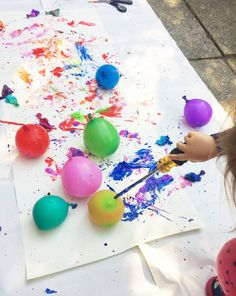 Paint filled popping balloon activity