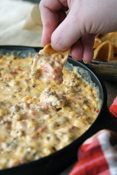 This dreamy Cheesy Sausage Dip is perfect for game day or any day! There's a stovetop and slow cooker version! #easy #recipes #dips #appetizers #partyfood
