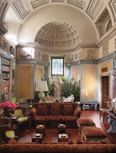 Carraro Residence, Rome, 1975. Mongiardino created distinct upper and lower zones in the living room of the 17th-century building. Halfway up the 20-foot-high walls, his frescoes abruptly stop, allowing the restored pale vaulted neo-Classical ceiling to take center stage. The space is testament to the designer's ability to make imposing spaces feel more intimate. Simon Upton