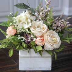 Love this white washed wood box filled with beautiful florals.