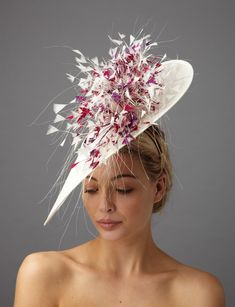 The Bardot dish hat comprises a sinamay dish base and a spray of cut coque  feathers 9a7cf6d581fd