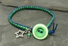 Navy leather and metallic green glass bead bracelet with green vintage button £10.00