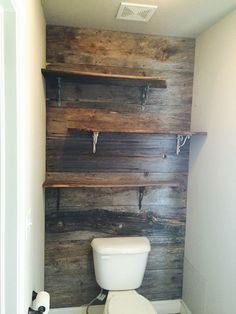 Another view with the shelves installed. Pallet Wall Bathroom, Bathroom Accent Wall, Bathroom Accents, Small Bathroom, Accent Walls, Rustic Bathroom Designs, Rustic Bathrooms, Toilet Closet, Ranch Decor