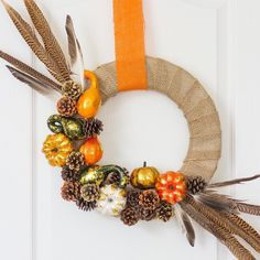 I love a beautiful fall wreath on the front door at this time of year. With pumpkins, gourds, pine cones, and pheasant feathers, this rustic DIY wreath screams fall! Fall Crafts, Halloween Crafts, Holiday Crafts, Holiday Decor, Elegant Fall Wreaths, Christmas Front Doors, Diy Wedding Projects, Thanksgiving Decorations, Diy Thanksgiving