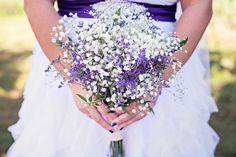 Amanda carried baby's breath and dried purple statice in her bouquet.