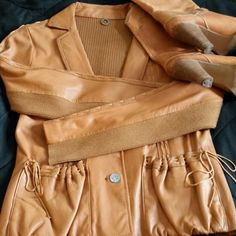"""Anthro Leather/Knit Jacket Unusual leather jacket, will lacing detail. Leather is soft and beautiful. Back of jacket and sleeves are neat band color matches perfectly. Brand is One Girl Who. Sweater portion is rayon and nylon. 21"""" shoulder to hem, and sleeves are 23"""". No size tag, this would fit XS/SM. Like new condition.  I don't trade, but welcome reasonable offers. Thanks for shopping. Anthropologie Jackets & Coats"""