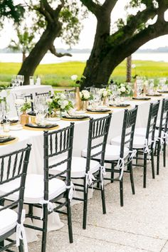 Black Chiavari Chairs at Family Style Tables | Gold, Black, White + Green Lowndes Grove Plantation Wedding by Charleston wedding photographer Dana Cubbage Weddings