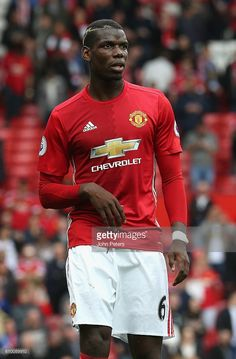 Paul Pogba of Manchester United looks on during the Premier League match between Manchester United and Leicester City at Old Trafford on September 24, 2016 in Manchester, England.