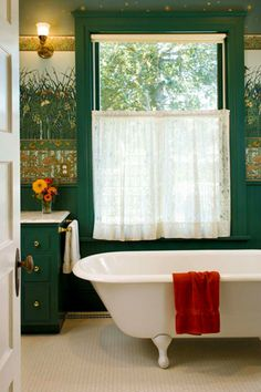 A clawfoot tub and multi-part wall treatment over a wood wainscot are suitable for the 1901 transitional house. Hex-tile floor and roller shade with lace curtain complete the coherent look. Photo by William Wright. Transitional Coffee Tables, Transitional Lighting, Transitional Living Rooms, Transitional House, Bathroom Window Treatments, Bathroom Windows, Wall Treatments, Craftsman Bathroom, Arts And Crafts House