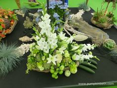 This stunning arrangement of vegetables and Gladioli was created by Janet Arm from the Aldershot Floral Design Club.  This lovely floral and vegetable arrangement sits in a trug and formed part of a larger exhibit, created by the Aldershot Floral Design Club, for the RHS Hampton Court Palace Flower Show 2017.  This lovely photograph was taken by Janet Arm. Rhs Hampton Court, Gladioli, Food Shows, Flower Show, How To Make Notes, Cut Flowers, Exhibit, The Hamptons, Floral Arrangements