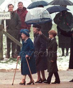 Harry carrying umbrella for his Grandma & Great Grandma.  Newscom Image : rexphotos803572