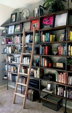 Bookcases-Bookcases-Bookcases-DIY Industrial Shelves on a Budget Think outside the box when it comes to updating spaces in your home that sit empty or get little attention. These large floor-to-ceiling shelves provide great storage as well as decor. Pipe Bookshelf, Floor To Ceiling Bookshelves, Black Bookshelf, Black Pipe Shelving, Diy Shelving, Diy Regal, Industrial House, Industrial Furniture, Diy Industrial Bookshelf