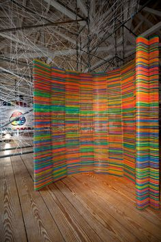 chromatic screen made by portuguese designers diogo agular and teresa otta of LIKEarchitects using two-thousand children's hangers from ikea