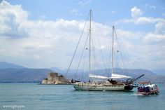 Peak hour in the port of #Nafplio. A sail boat crossing the channel on the way out of #Nafplio followed by a taxi-boat taking tourists to #Bourtzi fortress. #Peloponnese - #Greece