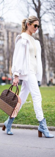 Brazilian style blogger Helena Bordon wears an all-white ensemble, including a Dior jacket, Rochas jumper, Current/Elliott jeans, plus Louis Vuitton Bag