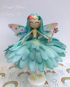 Pretty Blue Flower Fairy Doll named Marina, Miniature Fairy Ornament, Collectable Rainbow fairy Doll, would make a lovely Gift for Girls, Birthday Present, Guardian Angel. Pretty Fairy Cake Topper. Marina has handmade rainbow coloured wings, with glitter and hearts which captures the