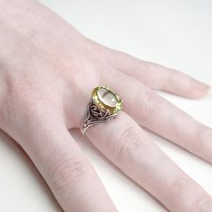 Elven Leaf Ring: Citrine and Sterling Silver - yellow quartz, intricate leaf setting, golden, sunshine, 14x10mm faceted oval, size 6.5. $92.00, via Etsy.    Loving this as well... very Elvish, and totally me.