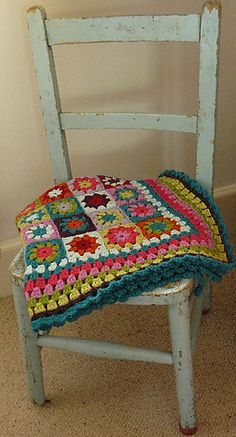 Gorgeous picture. Love how the chair and the granny square blanket go together in style. Beautiful earthy vintage color theme. Me love love love everything about this.