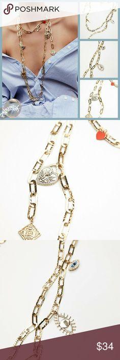 Free People Eternal Charm Necklace Free People Eternal Charm Necklace.  Layered Metal Necklace featuring multiple charms. Adjustable fit. Lobster clasp closure. Lenght is approximately 16.5 inches and the extender is approximately 3.25 inches. New with tags. Free People Jewelry Necklaces