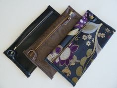 small soft clutch, soild colors with various textures, in faux leathers and tapestries with fun linings including denium