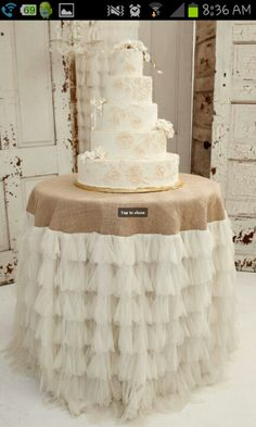 Cute wedding cake table cloth @ ann... add some rhinestones to the white and some decorations around the cake...