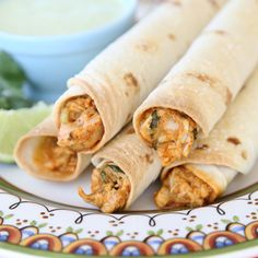 Creamy Chicken Taquitos: These. Are. Amazing.  Make ahead and freeze for easy meals (perfect with beans & rice).  Also works great with leftover pulled pork.  From Our Best Bites