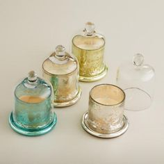 One of my favorite discoveries at WorldMarket.com: Mercury Glass Scented Filled Candle Cloches, Set of 4