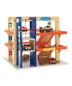 Mini motorists can store and drive many vehicles with this super garage. It comes with a working elevator to zoom vehicles in and out of storage with ease. See how it works
