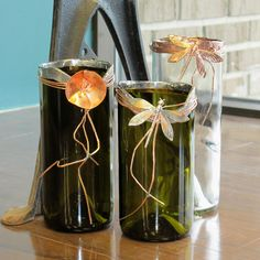 C. Lizzy's- Old wine bottles shaved and lined with copper (beautiful vase and piece of art) $37.50 each