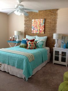 Turquoise, green, and red tropical bedroom.  Love the bright colors!