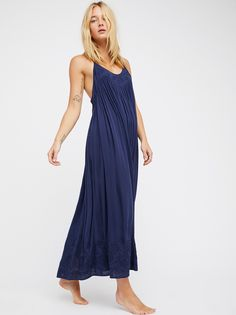 Embroidered Elaine Maxi Slip   Embroidered maxi slip dress with tonal detailing along the hem and bust.    * Racerback * Flowy Skirt