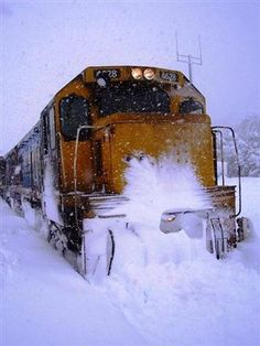 NZR train pushing through the snow