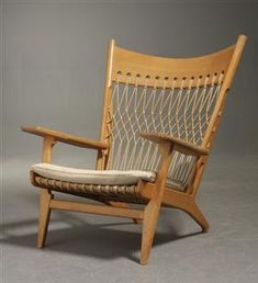 Hans Wegner; #JH-719 Lounge Chair for Johannes Hansens Møbelsnedkeri, 1968. source lauritz.com