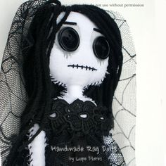 Weeping Widow. Sadness has puncture her heart leaving her empty. =( Adopt a Rag Doll  by Lupe Flores  Handmade unique in every stitch.   $45.00  www.artbylupeflores.com