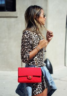 Animal print dress, denim jacket and red chanel shoulder bag.