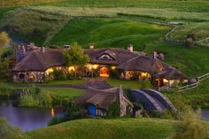 "Hobbiton village – ""Lord of the Rings"" movie location in New Zealand. Description from prayingforoneday.wordpress.com. I searched for this on bing.com/images"